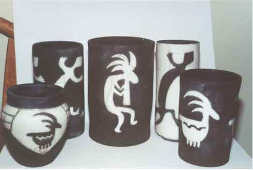 Collection of Raku work done with the Kokopelli, gecko, and ram motifs