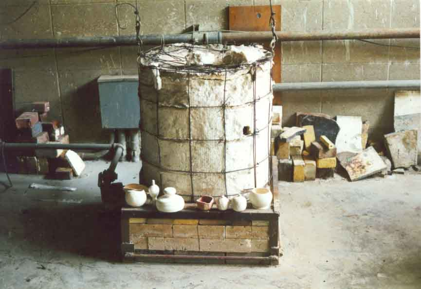 A Raku kiln surrounded by glazed bisque ware waiting to be fired