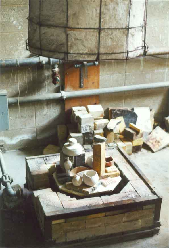 Raku kiln fully loaded and ready for firing. Notice how the glazed pottery is not overextending the firing area within the kiln